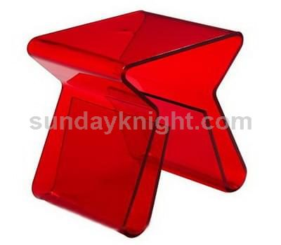 Transparent red acrylic coffee table