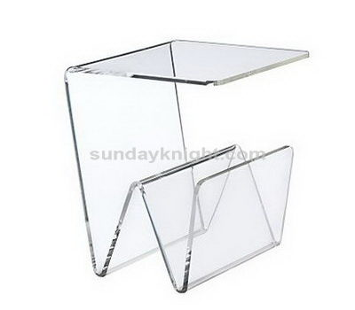 Clear acrylic table with magazine holder