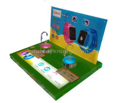 Children watch display stands