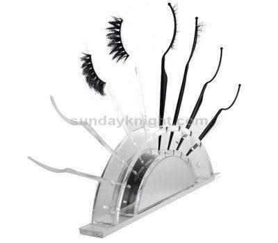 Eye lash brush display stand