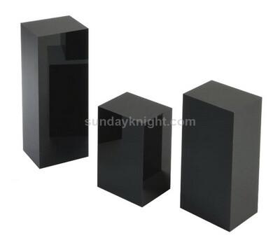 Custom black acrylic pedestal