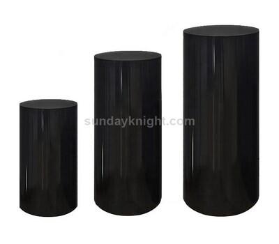 black acrylic cylinder pedestal